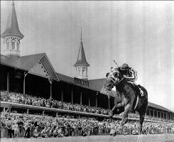 Secretariat, ridden by jockey Ron Turcotte, crosses the finish line alone to win the Kentucky Derby on May 5, 1973. The horse and jockey went on to win the Triple Crown.