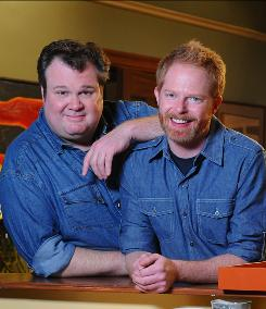 Actors Eric Stonestreet, left, and Jesse Tyler Ferguson play a gay couple raising an adopted daughter on ABC's Modern Family.