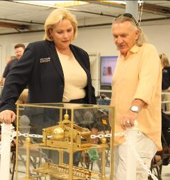 Going once, going twice ... sold! Auctioneer Deb Weidenhamer studies an unusual rolling ball clock with a potential buyer on Auctioneers, which tells you what items are valued at and what they sell for.