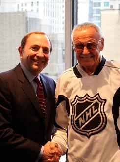 Put 'er there: NHL Commissioner Gary Bettman, left, and Stan Lee.