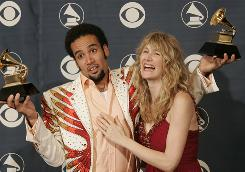 In happier times: Ben Harper celebrates his two Grammy Awards backstage with Laura Dern in 2005.