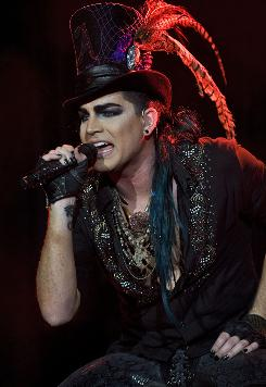 Adam Lambert has pledged to be on his best behavior when he performs in Malaysia on Thursday. Other acts such as Gwen Stefani and Fergie toned down their shows to comply with the country's conservative culture.