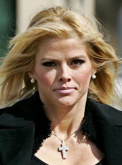 Anna Nicole Smith leaves the U.S. Supreme Court in Washington in 2006.