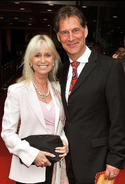 British actor Simon MacCorkindale, shown here with his wife Susan George, died Thursday. He was 58. MacCorkindale was best known to American audiences for his work on the popular 1980s soap Falcon Crest.