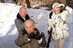 Still out in the cold: Bruce Willis, left, John Malkovich and Helen Mirren star in RED as retired CIA operatives.