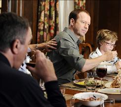 Family meal: Danny Reagan (Donnie Wahlberg) sits down to dinner with his father, Frank (Tom Selleck), left, and the rest of the clan in Blue Bloods. A similar scene in the pilot is what drew Wahlberg to the role.