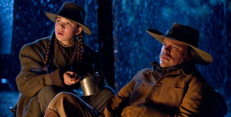 "Three guys and a little lady: Hailee Steinfeld is frontier girl Mattie Ross, and Matt Damon plays LeBoeuf, a Texas Ranger who joins Bridges' Rooster Cogburn on the trail of Josh Brolin, the man who killed her father. Around such a guy-centric cast, Steinfeld found it easy to bond. ""They all have daughters. So they knew,"" she says."