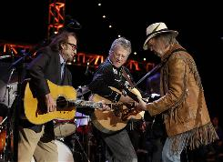 Stephen Stills, left, Richie Furay and Neil Young, three of the five original members of Buffalo Springfield perform for the Bridge School benefit concert in Mountain View, Calif.