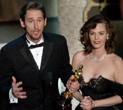 Lisa Blount has died at age 53. Here, she and her husband, Ray McKinnon, accept the Oscar for best live action short film for The Accountant  in 2002.