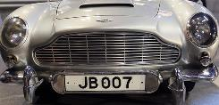 The1964 Aston Martin DB5 car used in the classic James Bond films Goldfinger and Thunderball fetched $4.1 million at auction on Wednesday in London.