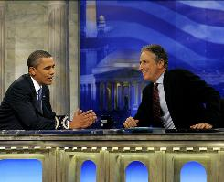President Obama chats with Daily Show host Jon Stewart during a commercial break in taping.