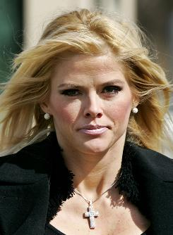 In this Feb. 28, 2006 photo, Anna Nicole Smith, leaves the U.S. Supreme Court in Washington.
