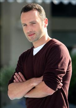 "British actor Andrew Lincoln, best known in the USA for playing the guy who holds the cards in Love Actually, says new series Walking Dead lets him ""start again somewhat in perception."""