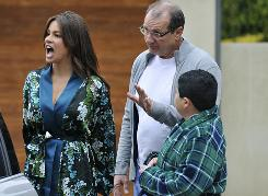 Sofia Vergara, Ed O'Neill and Rico Rodriguez confront a neighbor about his dog in a scene from ABC's Modern Family.
