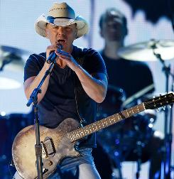 Kenny Chesney is teaming up with the Zac Brown Band for nine stadium dates in 2011.
