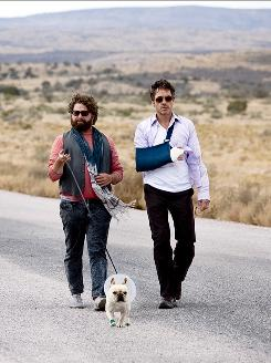 On the road: Robert Downey Jr., right, gets caught up in shenanigans with Zach Galifianakis while on his way back to L.A. for his baby's birth.