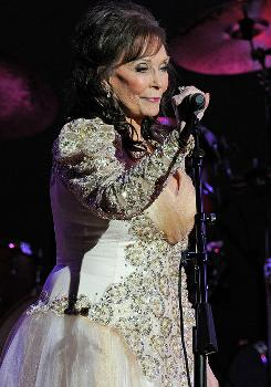 "Loretta Lynn performs at a Grammy salute to her career last month in Nashville. On Wednesday, she'll be honored at the Country Music Association Awards, and ""I'll be there with bells on,"" she says."