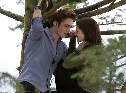 Robert Pattinson and Kristen Stewart get cozy in a tree in Twilight.