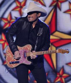 Two for the show: Co-hosts Carrie Underwood and Brad Paisley open the ceremonies Wednesday night at the Bridgestone Arena in Nashville.