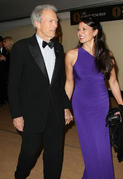 Clint Eastwood and his wife, Dina, attend the awards show. Eastwood presented actor Eli Wallach with the honorary Oscar.