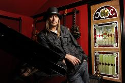 Kid Rock surrounds himself with things he loves in his home studio north of Detroit. His Born Free is in stores Tuesday.