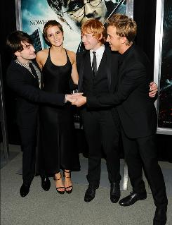 "Cast reunion: Daniel Radcliffe, left, Emma Watson, Rupert Grint and Tom Felton have worked together for 10 years. ""I remember the first time we were walking into the Great Hall as 11- or 12-year-olds,"" Felton said."