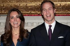 Prince William and Kate Middleton pose for photographs in the State Apartments of St. James Palace in London, England.