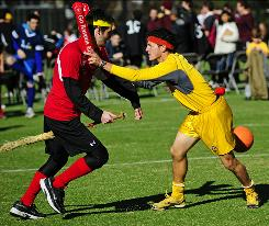 Competitors take part in a match of Quidditch, a game played on broomsticks in Harry Potter and adapted for real life on college campuses nationwide, during the fourth Quidditch World Cup last weekend in New York. 