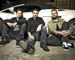 The guys behind the wheel: Tanner Foust, left, Adam Ferrara and Rutledge Wood are the co-hosts of the U.S. version of Top Gear. The BBC/History collaboration premieres Sunday. 