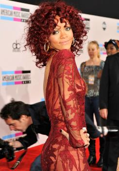 The lady in red: Rihanna's curly red hair drew a lot of attention.