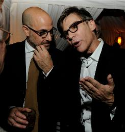 Actor Stanley Tucci, left, and writer/director Steve Antin talk at the after-party for the premiere of Burlesque.