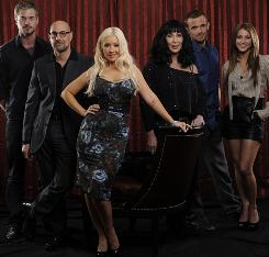 Dancing and the stars: Eric Dane, left, Stanley Tucci, Christina Aguilera, Cher, Cam Gigandet and Julianne Hough star in the musical, opening today.