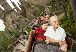 Michael Douglas and wife Catherine Zeta-Jones along with their children Dylan, 10, and Carys, 7, fly over The Wizarding World of Harry Potter at Universal Orlando Resort during the Thanksgiving holiday.