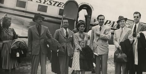 Walt Disney (third from right), his wife Lillian, and several colleagues step off the plane in Rio de Janeiro at the start of a nine week-long trip through Latin American countries. The studios insurance policy prohibited more than six of Disney's team members to travel on the same plane with him.