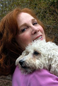 Rachel Hirschfeld takes a picture with her late dog Soupbone, the pet that prompted her to develop sure-fire ways for owners to include their beloved animals in their estate planning.