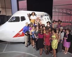Oprah Winfrey with audience members after announcing on her show in September that she would be taking them on a trip to Australia.