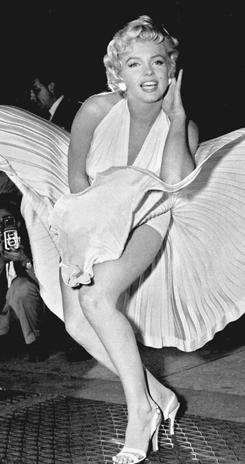 In this iconic photo from 1954, actress Marilyn Monroe poses over the updraft of a New York subway grating while in character for the filming of The Seven Year Itch.