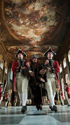 At St. James's Palace:, Royal Guards drag Captain Jack (Johnny Depp) for a forced audience with King George.