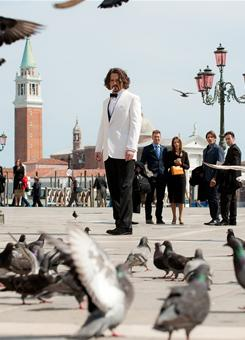 Fans flock to him: Johnny in The Tourist but what you don't see on-screen is the crowd of bystanders trying to glimpse him on the set. So while filming in Venice, Italy, the actor did his sightseeing at night.
