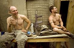 Specialist Misha Pemble-Belkin, left, and Ross Murphy of Battle Company, 173rd U.S. Airborne, relax at Outpost Restrepo in Afghanistan.