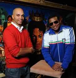 A wall full of memories: Artist Kadir Nelson, left, and Jackie Jackson, Michael's brother, in front of the 9-by-4.5-foot painting.