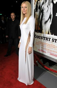 Gwyneth Paltrow shows some skin in a sexy Emilio Pucci gown at a screening of her new movie Country Strong in Beverly Hills Tuesday night.