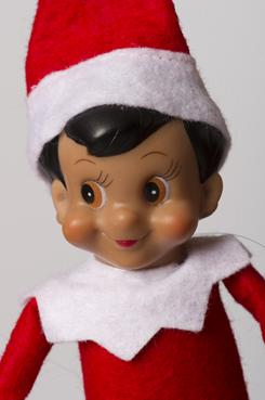 "The Elf on the Shelf comes with both light and dark skin, and blue or brown eyes. And if you prefer a little girl elf, a little white skirt is available in the ""Claus Couture Collection."""