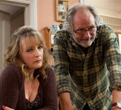 ;b>;Two ends of happiness spectrum: ;/b>; Mary (Lesley Manville) makes herself at home with her friend Tom (Jim Broadbent) and his wife.