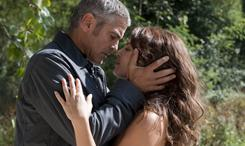 Jack (George Clooney) gets close to a local woman (Violante Placido) in The American.