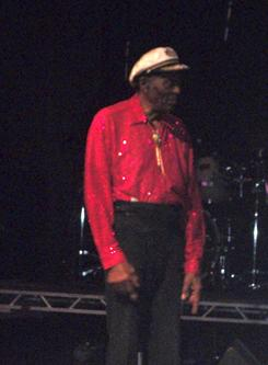 "Chuck Berry returns to the stage to thank the crowd and perform his famous ""heel scoot"" after he left to be examined by medics at a show in Chicago on Saturday."