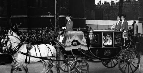 Royal tradition: Newlyweds the Duke of Edinburgh and then-princess Elizabeth ride in the Glass Coach from Westminster Abbey back to Buckingham Palace after their ceremony on Nov. 20, 1947.