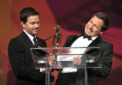 Actor Mark Wahlberg, left, presents David O. Russell with the Director of the Year Award at the Palm Springs International Film Festival Awards Gala on Saturday. Russell director Wahlberg in The Fighter.
