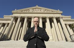 Author Brad Meltzer pauses on the steps of the National Archives, which figures in the plot of The Inner Circle, out Tuesday.