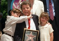 David Nelson gets a hug from his grandson, Michael Woolery, and family friend, Ashley Holt, as he is honored with the 2,065th star on the Hollywood Walk of Fame in 1996. Nelson, who starred on his parents' popular television show, The Adventures of Ozzie and Harriet  died Monday. He was 74.